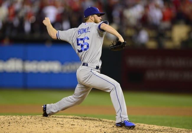 Oct 11, 2013; St. Louis, MO, USA; Los Angeles Dodgers relief pitcher J.P. Howell throws a pitch against the St. Louis Cardinals during the 11th inning in game one of the National League Championship Series baseball game at Busch Stadium. Mandatory Credit: Jeff Curry-USA TODAY Sports