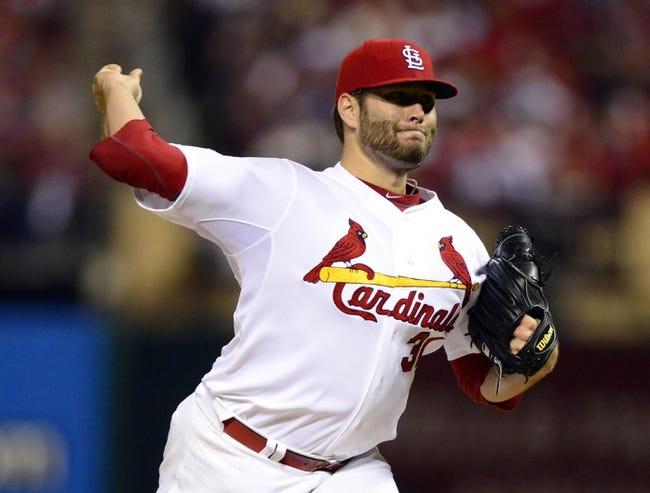 Oct 11, 2013; St. Louis, MO, USA; St. Louis Cardinals pitcher Lance Lynn throws a pitch against the Los Angeles Dodgers during the 12th inning in game one of the National League Championship Series baseball game at Busch Stadium. Mandatory Credit: Jeff Curry-USA TODAY Sports