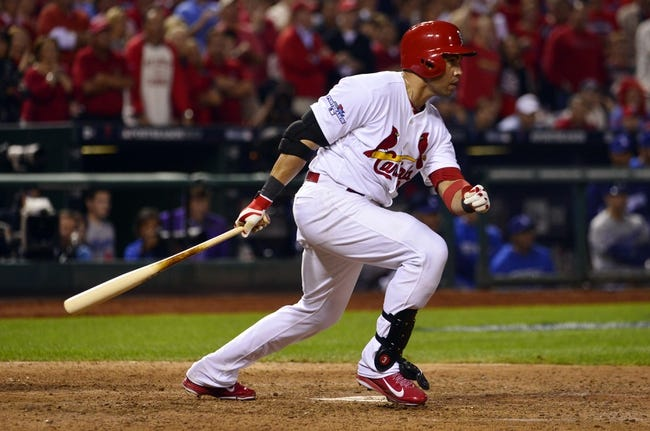 Oct 11, 2013; St. Louis, MO, USA; St. Louis Cardinals right fielder Carlos Beltran drives in the winning run in the 13th inning against the Los Angeles Dodgers in game one of the National League Championship Series baseball game at Busch Stadium. Mandatory Credit: Scott Rovak-USA TODAY Sports