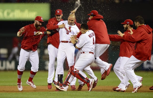 Oct 11, 2013; St. Louis, MO, USA; St. Louis Cardinals right fielder Carlos Beltran (3) celebrates with teammates after hitting the game-winning single in the 13th inning against the Los Angeles Dodgers in game one of the National League Championship Series baseball game at Busch Stadium. Mandatory Credit: Jeff Curry-USA TODAY Sports