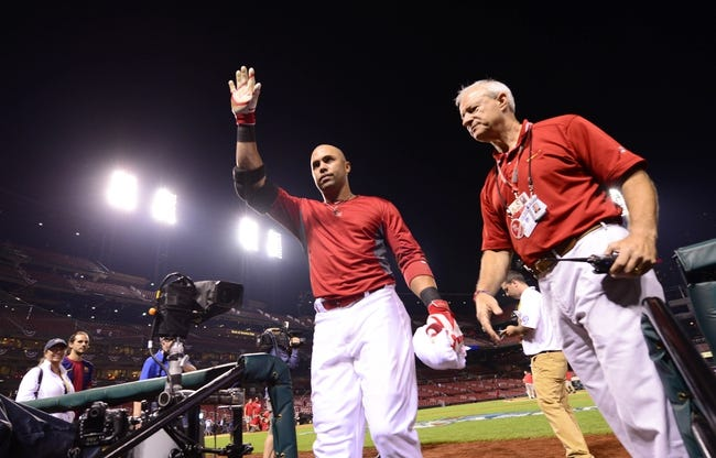 Oct 11, 2013; St. Louis, MO, USA; St. Louis Cardinals right fielder Carlos Beltran waves to the crowd as he leaves the field after game one of the National League Championship Series baseball game against the Los Angeles Dodgers at Busch Stadium. Mandatory Credit: Scott Rovak-USA TODAY Sports