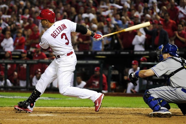 Oct 11, 2013; St. Louis, MO, USA; St. Louis Cardinals right fielder Carlos Beltran hits the game-winning single in the 13th inning against the Los Angeles Dodgers in game one of the National League Championship Series baseball game at Busch Stadium. Mandatory Credit: Jeff Curry-USA TODAY Sports
