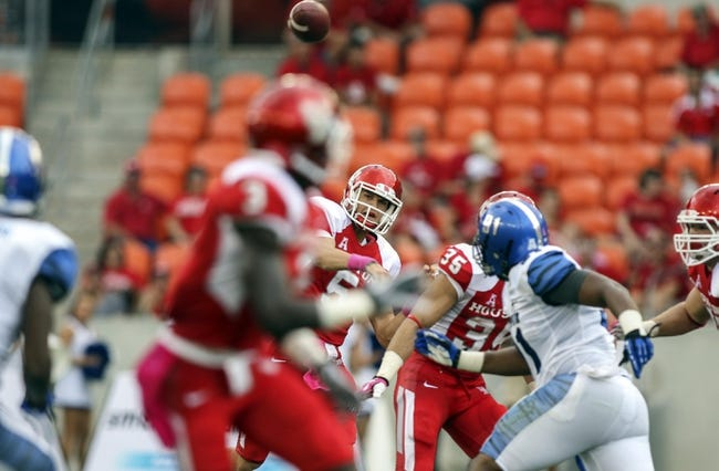 Oct 12, 2013; Houston, TX, USA; Houston Cougars quarterback John O'Korn (5) attempts a pass during the first quarter against the Memphis Tigers at BBVA Compass Stadium. Mandatory Credit: Troy Taormina-USA TODAY Sports