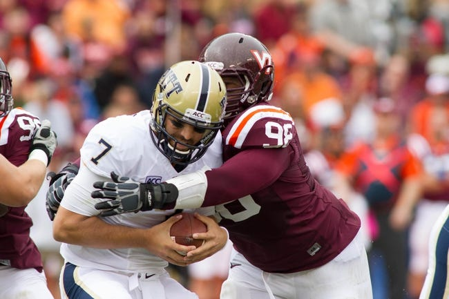 Oct 12, 2013; Blacksburg, VA, USA; Virginia Tech Hokies defensive tackle Derrick Hopkins (98) sacks Pittsburgh Panthers quarterback Tom Savage (7) during the second quarter at Lane Stadium. Mandatory Credit: Jeremy Brevard-USA TODAY Sports