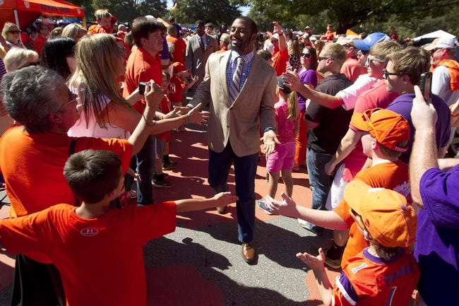 Oct 12, 2013; Clemson, SC, USA; Clemson Tigers quarterback Tajh Boyd (center) greets fans during the Tigerwalk prior to the game against the Boston College Eagles at Clemson Memorial Stadium. Mandatory Credit: Joshua S. Kelly-USA TODAY Sports