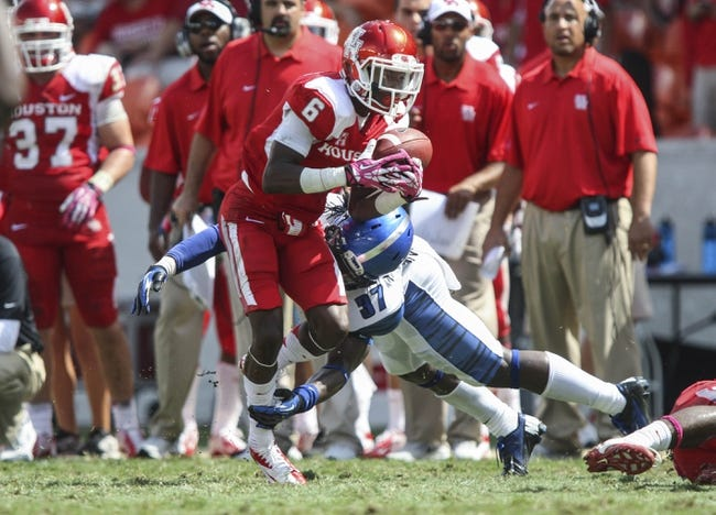 Oct 12, 2013; Houston, TX, USA; Houston Cougars wide receiver Larry McDuffey (6) makes a reception during the second quarter as Memphis Tigers defensive back Bakari Hollier (37) defends at BBVA Compass Stadium. Mandatory Credit: Troy Taormina-USA TODAY Sports