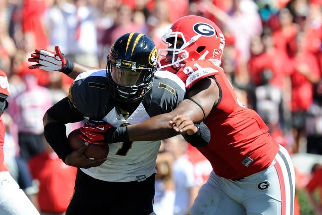 Oct 12, 2013; Athens, GA, USA; Georgia Bulldogs defensive end Josh Dawson (91) tackles Missouri Tigers quarterback James Franklin (1) during the second quarter at Sanford Stadium. Mandatory Credit: Dale Zanine-USA TODAY Sports