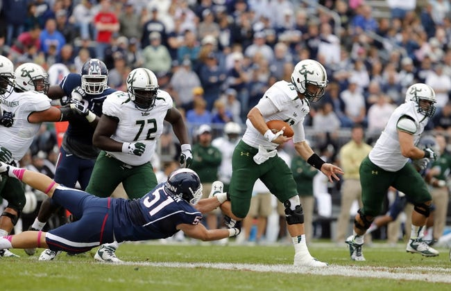 Oct 12, 2013; East Hartford, CT, USA; South Florida Bulls quarterback Bobby Eveld (13) runs the ball against Connecticut Huskies defensive end Tim Willman (51) in the second quarter at Rentschler Field. Mandatory Credit: David Butler II-USA TODAY Sports