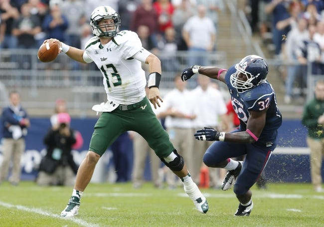 Oct 12, 2013; East Hartford, CT, USA; South Florida Bulls quarterback Bobby Eveld (13) looks to throw under pressure from Connecticut Huskies linebacker Jefferson Ashiru (32) in the second quarter at Rentschler Field. Mandatory Credit: David Butler II-USA TODAY Sports