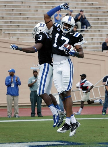 Oct 12, 2013; Durham, NC, USA; Duke Blue Devils wide receiver Jamison Crowder (3) celebrates with wide receiver Issac Blakeney (17) after Blakeney scored against Navy Midshipmen at Wallace Wade Stadium. Mandatory Credit: Mark Dolejs-USA TODAY Sports