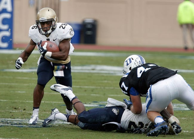 Oct 12, 2013; Durham, NC, USA; Navy Midshipmen running back Marcus Thomas (26) runs the ball against the Duke Blue Devils at Wallace Wade Stadium. Mandatory Credit: Mark Dolejs-USA TODAY Sports