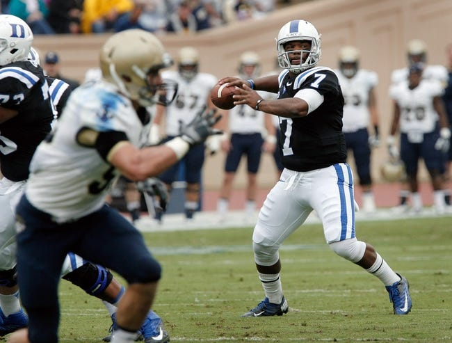Oct 12, 2013; Durham, NC, USA; Duke Blue Devils quarterback Anthony Boone (7) looks to pass against the Navy Midshipmen at Wallace Wade Stadium. Mandatory Credit: Mark Dolejs-USA TODAY Sports