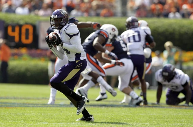 Oct 12, 2013; Auburn, AL, USA; Western Carolina Catamounts receiver Karnorris Benson (14) catches a pass during the first half against the Auburn Tigers at Jordan Hare Stadium. Mandatory Credit: John Reed-USA TODAY Sports