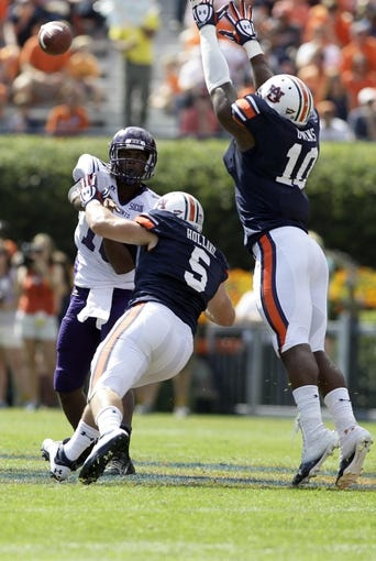 Oct 12, 2013; Auburn, AL, USA; Western Carolina Catamounts quarterback Troy Mitchell (10) throws a pass over Auburn Tigers linebacker Jake Holland (5) and defensive end LaDarius Owens (10) during the first half at Jordan Hare Stadium. Mandatory Credit: John Reed-USA TODAY Sports