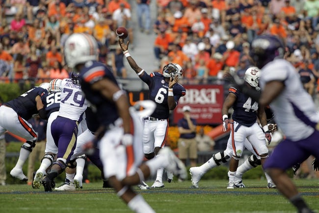 Oct 12, 2013; Auburn, AL, USA; Auburn Tigers quarterback Jeremy Johnson (6) throws a pass against the Western Carolina Catamounts during the first half at Jordan Hare Stadium. Mandatory Credit: John Reed-USA TODAY Sports