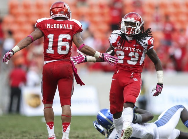 Oct 12, 2013; Houston, TX, USA; Houston Cougars defensive back Trevon Stewart (23) is congratulated by defensive back Adrian McDonald (16) after a defensive play during the fourth quarter against the Memphis Tigers at BBVA Compass Stadium. The Cougars defeated the Tigers 25-15. Mandatory Credit: Troy Taormina-USA TODAY Sports