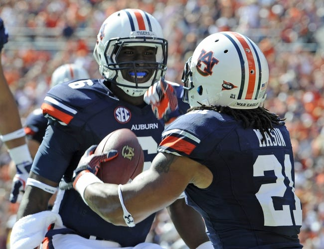Oct 12, 2013; Auburn, AL, USA; Auburn Tigers quarterback Jeremy Johnson (6) and running back Tre Mason (21) celebrate a touchdown in the first half against the Western Carolina Catamounts at Jordan Hare Stadium. Mandatory Credit: Shanna Lockwood-USA TODAY Sports