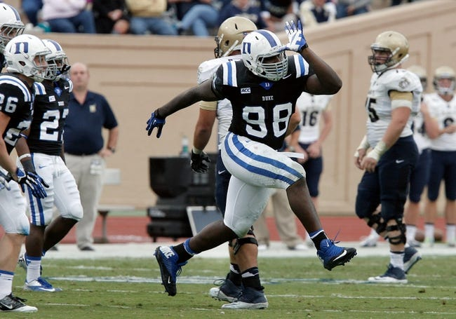 Oct 12, 2013; Durham, NC, USA; Duke Blue Devils nose tackle Carlos Wray (98) celebrates after recovering a Navy Midshipmen fumble in the fourth quarter at Wallace Wade Stadium. Mandatory Credit: Mark Dolejs-USA TODAY Sports