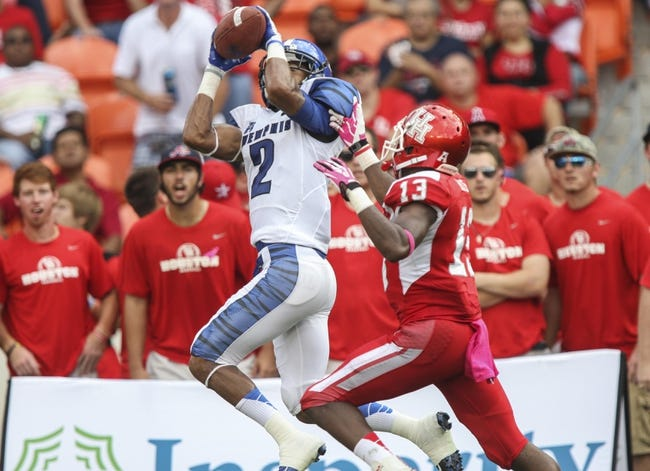 Oct 12, 2013; Houston, TX, USA; Memphis Tigers wide receiver Joe Craig (2) is unable to catch a pass during the third quarter as Houston Cougars defensive back Thomas Bates (13) defends at BBVA Compass Stadium. The Cougars defeated the Tigers 25-15. Mandatory Credit: Troy Taormina-USA TODAY Sports