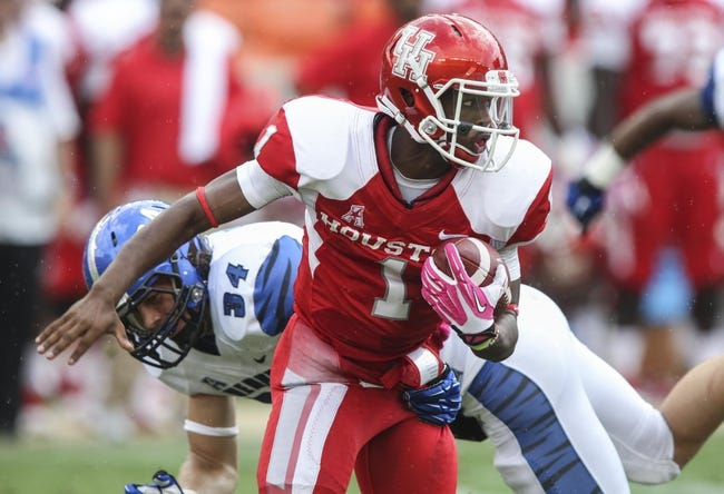 Oct 12, 2013; Houston, TX, USA; Houston Cougars quarterback Greg Ward (1) runs with the ball during the third quarter against the Memphis Tigers at BBVA Compass Stadium. The Cougars defeated the Tigers 25-15. Mandatory Credit: Troy Taormina-USA TODAY Sports