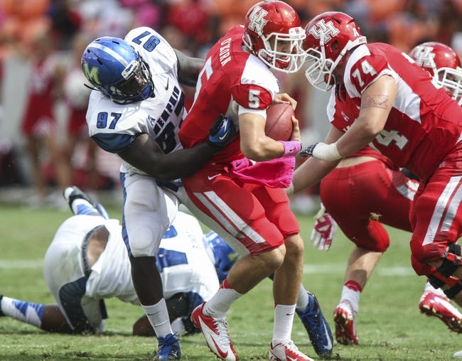 Oct 12, 2013; Houston, TX, USA; Houston Cougars quarterback John O'Korn (5) is sacked  by Memphis Tigers defensive lineman Martin Ifedi (97) during the third quarter at BBVA Compass Stadium. The Cougars defeated the Tigers 25-15. Mandatory Credit: Troy Taormina-USA TODAY Sports