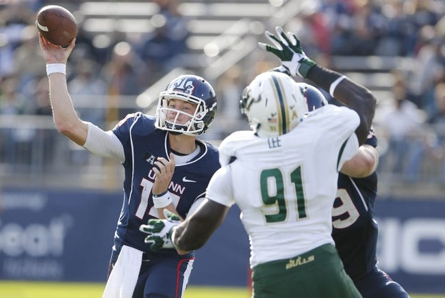 Oct 12, 2013; East Hartford, CT, USA; Connecticut Huskies quarterback Tim Boyle (14) throws a pass against the South Florida Bulls in the second half at Rentschler Field. South Florida defeated Connecticut 13-10. Mandatory Credit: David Butler II-USA TODAY Sports