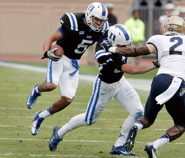 Oct 12, 2013; Durham, NC, USA; Duke Blue Devils wide receiver Brandon Braxton (5) runs behind a block against the Navy Midshipmen at Wallace Wade Stadium. Mandatory Credit: Mark Dolejs-USA TODAY Sports