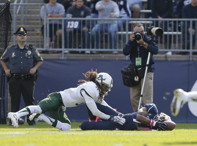 Oct 12, 2013; East Hartford, CT, USA; Connecticut Huskies wide receiver John Green (7) catches the ball against South Florida Bulls defensive back Brandon Salinas (31) but the play was ruled incomplete in the second half at Rentschler Field. South Florida defeated Connecticut 13-10. Mandatory Credit: David Butler II-USA TODAY Sports