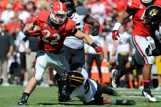 Oct 12, 2013; Athens, GA, USA; Georgia Bulldogs running back Brendan Douglas (22) tries to break a tackle by Missouri Tigers safety Braylon Webb (9) during the second half at Sanford Stadium. Missouri defeated Georgia 41-26. Mandatory Credit: Dale Zanine-USA TODAY Sports