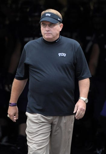 Oct 12, 2013; Fort Worth, TX, USA; TCU Horned Frogs coach Gary Patterson leads players onto the field before the game against the Kansas Jayhawks at Amon G. Carter Stadium. Mandatory Credit: Kirby Lee-USA TODAY Sports