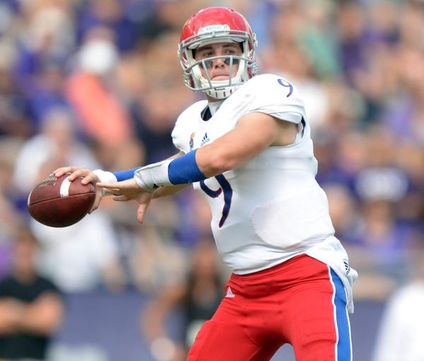 Oct 12, 2013; Fort Worth, TX, USA; Kansas Jayhawks quarterback Jake Heaps (9) throws a pass against the TCU Horned Frogs at Amon G. Carter Stadium. Mandatory Credit: Kirby Lee-USA TODAY Sports