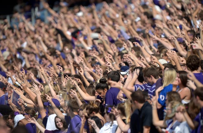 Oct 12, 2013; Fort Worth, TX, USA; TCU Horned Frogs hold up the Horned Frogs hand symbol during the game against the Kansas Jayhawks at Amon G. Carter Stadium. TCU defeated Kansas 27-17. Mandatory Credit: Kirby Lee-USA TODAY Sports