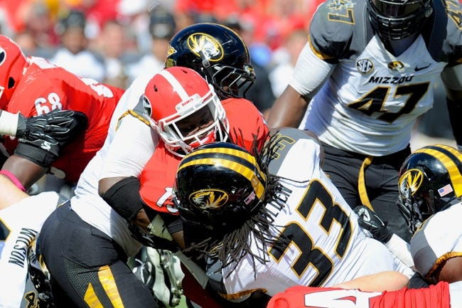 Oct 12, 2013; Athens, GA, USA; Missouri Tigers defensive lineman Markus Golden (33) tackles Georgia Bulldogs running back J.J. Green (15) during the second half at Sanford Stadium. Missouri defeated Georgia 41-26. Mandatory Credit: Dale Zanine-USA TODAY Sports
