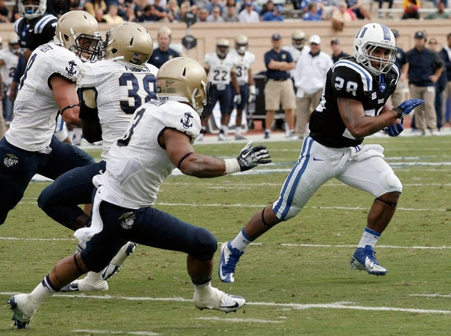Oct 12, 2013; Durham, NC, USA; Duke Blue Devils running back Shaquille Powell (28) runs around the Navy Midshipmen defense at Wallace Wade Stadium. Mandatory Credit: Mark Dolejs-USA TODAY Sports