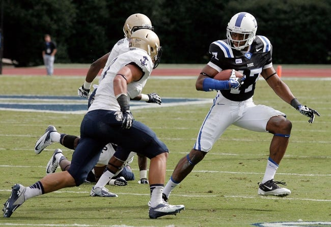 Oct 12, 2013; Durham, NC, USA; Duke Blue Devils wide receiver Issac Blakeney (17) runs against the Navy Midshipmen defense at Wallace Wade Stadium. Mandatory Credit: Mark Dolejs-USA TODAY Sports