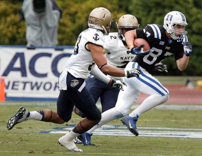 Oct 12, 2013; Durham, NC, USA; Duke Blue Devils wide receiver Max McCaffrey (87) runs with the ball against the Navy Midshipmen at Wallace Wade Stadium. Mandatory Credit: Mark Dolejs-USA TODAY Sports