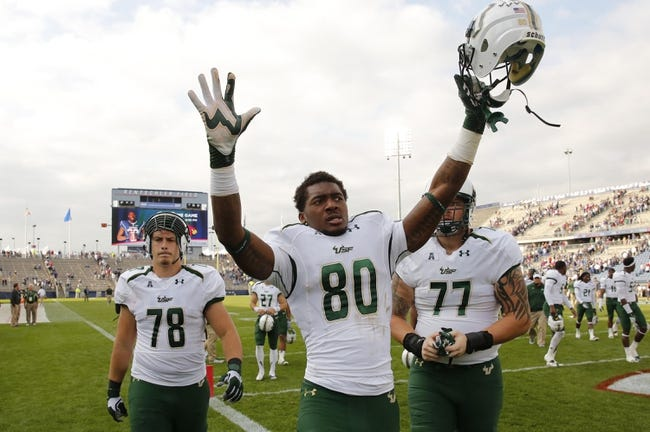 Oct 12, 2013; East Hartford, CT, USA; South Florida Bulls tight end Mike McFarland (80) and his teammates celebrate their win over the Connecticut Huskies at Rentschler Field. South Florida defeated Connecticut 13-10. Mandatory Credit: David Butler II-USA TODAY Sports