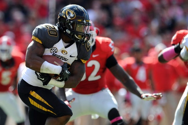 Oct 12, 2013; Athens, GA, USA; Missouri Tigers running back Henry Josey (20) runs with the ball against the Georgia Bulldogs during the second half at Sanford Stadium. Missouri defeated Georgia 41-26. Mandatory Credit: Dale Zanine-USA TODAY Sports