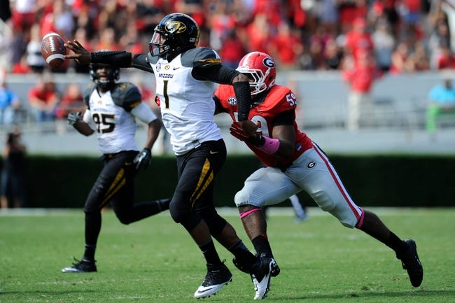 Oct 12, 2013; Athens, GA, USA; Missouri Tigers quarterback James Franklin (1) releases the ball before being hit by Georgia Bulldogs linebacker Jordan Jenkins (59) during the second half at Sanford Stadium. Missouri defeated Georgia 41-26. Mandatory Credit: Dale Zanine-USA TODAY Sports