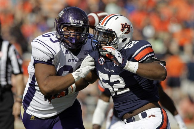Oct 12, 2013; Auburn, AL, USA; Auburn Tigers defensive end Justin DeLaine (52) blocks Western Carolina Catamounts lineman Matt Degraffinreed (63) during the second half at Jordan Hare Stadium.  The Tigers beat the Catamounts 62-3.  Mandatory Credit: John Reed-USA TODAY Sports