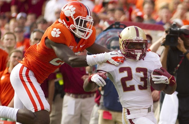 Oct 12, 2013; Clemson, SC, USA; Boston College Eagles running back Myles Willis (23) breaks a tackle during the second quarter against the Clemson Tigers at Clemson Memorial Stadium. Mandatory Credit: Joshua S. Kelly-USA TODAY Sports