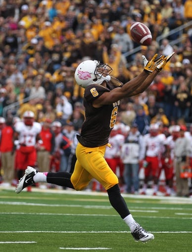 Oct 12, 2013; Laramie, WY, USA; Laramie, WY, USA; Wyoming Cowboys wide receiver Robert Herron (6) fails to make a reception against the New Mexico Lobos during the second quarter at War Memorial Stadium. Mandatory Credit: Troy Babbitt-USA TODAY Sports