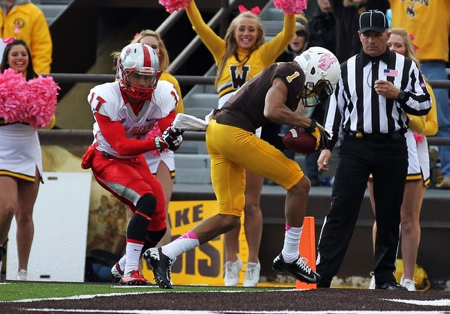Oct 12, 2013; Laramie, WY, USA; Laramie, WY, USA; Wyoming Cowboys wide receiver Jalen Claiborne (1) scores a  touchdown against New Mexico Lobos cornerback Jadon Boatright (17) during the second quarter at War Memorial Stadium. Mandatory Credit: Troy Babbitt-USA TODAY Sports
