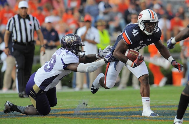 Oct 12, 2013; Auburn, AL, USA; Auburn Tigers running back Patrick Lymon (41) runs the ball during the second half against the Western Carolina Catamounts at Jordan Hare Stadium. The Tigers defeated the Catamounts 62-3. Mandatory Credit: Shanna Lockwood-USA TODAY Sports