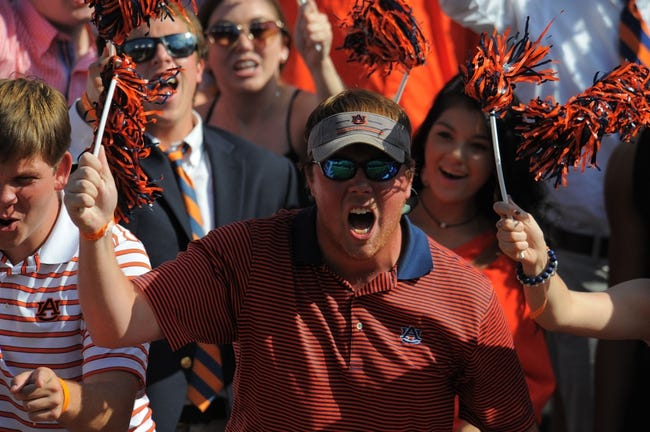 Oct 12, 2013; Auburn, AL, USA; Auburn Tigers fans cheer during the game against the Western Carolina Catamounts at Jordan Hare Stadium. The Tigers defeated the Catamounts 62-3. Mandatory Credit: Shanna Lockwood-USA TODAY Sports