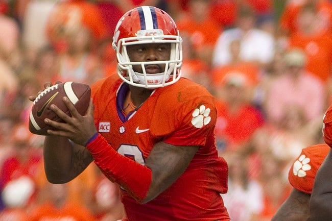 Oct 12, 2013; Clemson, SC, USA; Clemson Tigers quarterback Tajh Boyd (10) looks to pass the ball during the second quarter against the Boston College Eagles at Clemson Memorial Stadium. Mandatory Credit: Joshua S. Kelly-USA TODAY Sports