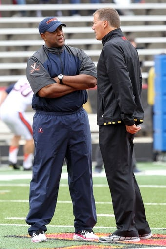 Oct 12, 2013; College Park, MD, USA; Virginia Cavaliers head coach Mike London talks with Maryland Terrapins head coach Randy Edsall prior to the game at Byrd Stadium. Mandatory Credit: Mitch Stringer-USA TODAY Sports