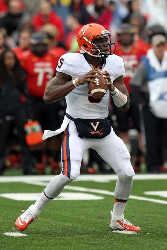 Oct 12, 2013; College Park, MD, USA; Virginia Cavaliers quarterback David Watford (5) drops back to pass against the Maryland Terrapins at Byrd Stadium. Mandatory Credit: Mitch Stringer-USA TODAY Sports