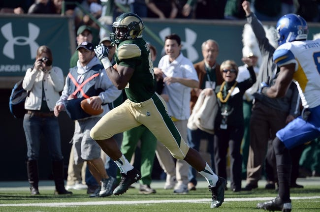 Oct 12, 2013; Fort Collins, CO, USA; Colorado State Rams tight end Kivon Cartwright (86) runs for his second touchdown against the San Jose State Spartans in the second quarter Hughes Stadium. Mandatory Credit: Ron Chenoy-USA TODAY Sports