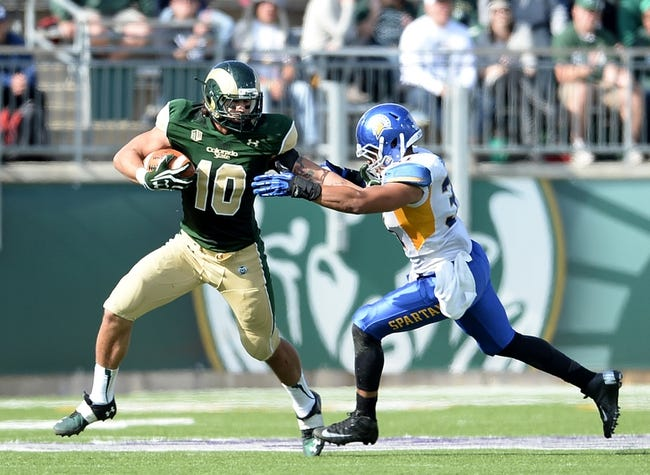 Oct 12, 2013; Fort Collins, CO, USA; Colorado State Rams tight end Crockett Gillmore (10) pushes off on San Jose State Spartans linebacker Keith Smith (31) in the second quarter at Hughes Stadium. Mandatory Credit: Ron Chenoy-USA TODAY Sports